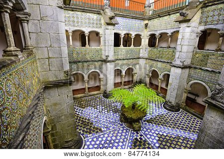 SINTRA, PORTUGAL - SEPTEMBER 19, 2014: A decorative plant sits at the center of the Pena National Palace interior courtyard.