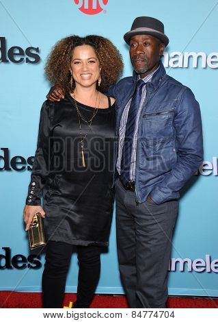 LOS ANGELES - JAN 05:  Don Cheadle & Bridgid Coulter arrives to Showtime celebrates all-new seasons of Shameless, House of Lies and Episodes  on January 5, 2015 in West Hollywood, CA