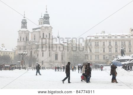 PRAGUE, CZECH REPUBLIC - FEBRUARY 23, 2013: Heavy snowfall covering the Saint Nicholas Church in Old Town Square in Prague, Czech Republic.