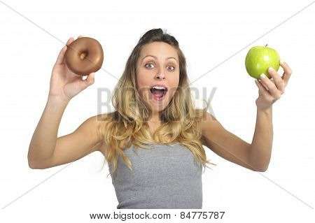 Attractive Woman Holding Apple And Chocolate Donut In Healthy Fruit Versus Sweet Junk Food Temptatio