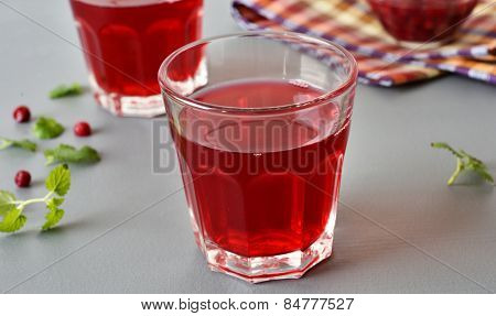 Lingonberry drink in a glass closeup