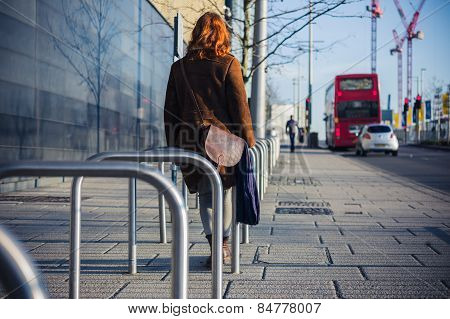 Woman Walking In A City In The Winter