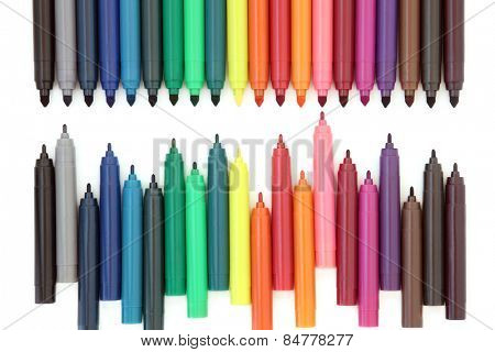 Coloured felt tip pens over white background.