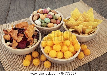 Savory snack party food selection in wooden bowls.