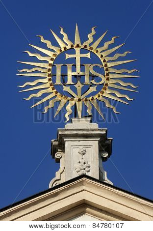 VIENNA, AUSTRIA - OCTOBER 10: IHS sign on baroque Jesuits church. The church was built between 1623 and 1627. in Vienna, Austria on October 10, 2014.