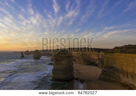 Sunset At Twelve Apostles Places On Green Ocean Road
