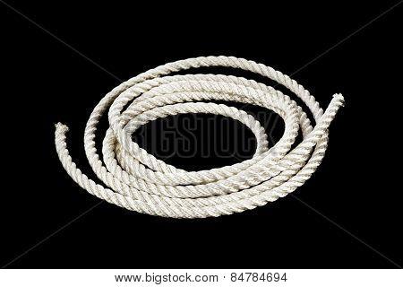 Roll of rope isolated on black background