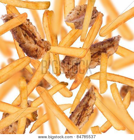 French fries with chicken strips in freeze motion isolated on white