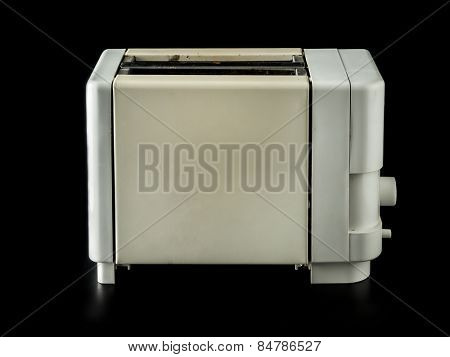 Old grunge toaster over black background