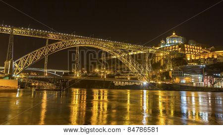 Famous Dom Luis I Bridge at night time in Porto, Portugal.