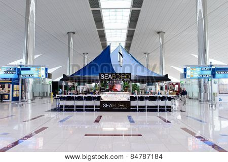 DUBAI, UAE - APRIL 18, 2014: airport interior. Dubai International Airport is an international airport serving Dubai. It is a major airline hub in the Middle East, and is the main airport of Dubai.