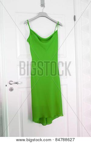 Green Dress hanging on a door