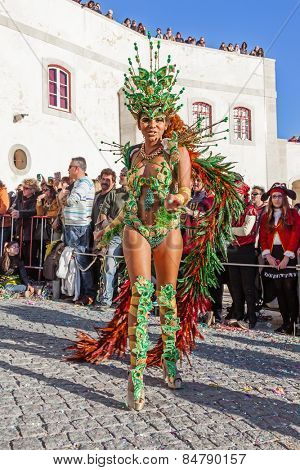 Sesimbra, Portugal. February 17, 2015: Brazilian Samba dancer called Passista in the Rio de Janeiro style Carnaval Parade. The Passista is one of the sexiest performers of this event