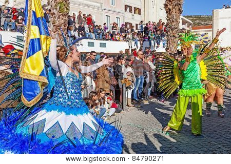 Sesimbra, Portugal. February 17, 2015: Porta Bandeira (Flag Bearer) and the Mestre Sala (Samba Host), two of the most prestigious characters of the Samba School in the Rio de Janeiro style Carnival