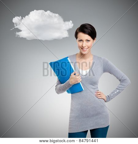 Girl holds books and magazines, isolated on grey