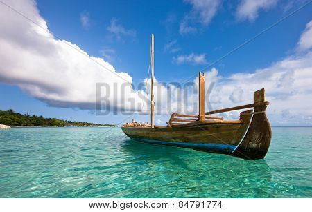Longtail boat on the water, Kuramathi island
