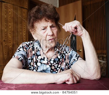 Old woman. Thinking elderly female at home