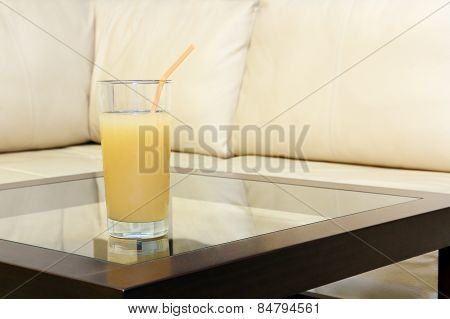 Glass Juice On Transparent Table.