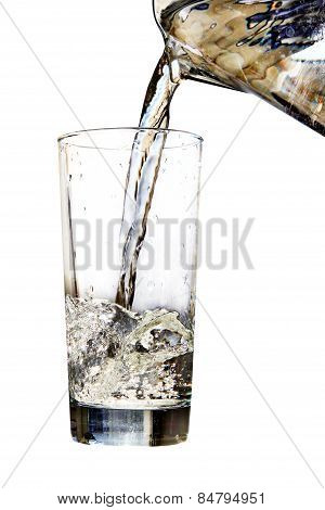 Water Jug Pouring To Glass On White Background
