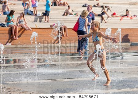 Young People Bathing In Dry Fountain