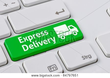 A Keyboard With A Green Button - Express Delivery