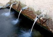 image of groundwater  - Source of three pipes with crystal clear water of the mountain - JPG