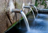 foto of groundwater  - Source of three pipes with crystal clear water of the mountain - JPG