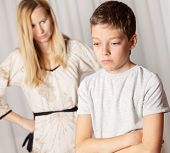 stock photo of disobedient  - Mom swears by son - JPG