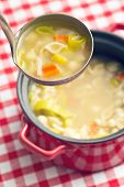 picture of vegetable soup  - vegetable soup with pasta in soup ladle - JPG