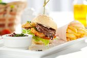stock photo of fried onion  - Sandwich with Beef and Deep Fried Onions Ring - JPG