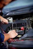 picture of auto garage  - Mechanic working in auto repair garage - JPG