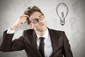 pic of scratching head  - Young geeky businessman scratching his head against white background - JPG
