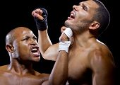 stock photo of sparring  - sparring mma fighters or boxers punching each other - JPG