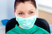 foto of speculum  - Portrait of a serious surgeon with mask in a hospital - JPG