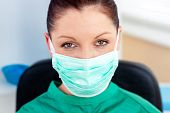 picture of speculum  - Portrait of a confident surgeon in her office looking at the camera - JPG