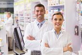 picture of pharmaceutical  - Team of pharmacists smiling at camera at the hospital pharmacy - JPG