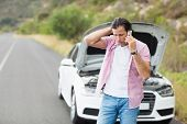 picture of breakdown  - Man after a car breakdown at the side of the road - JPG