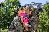 picture of reunited  - Army parents reunited with their daughter on a sunny day - JPG