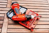 stock photo of drill bit  - Group of bit and drill driver on the table - JPG