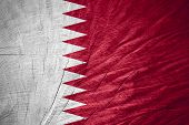 stock photo of qatar  - Qatar flag or banner on wooden texture - JPG