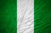 stock photo of nigeria  - Nigeria flag or Nigerian banner on wooden texture - JPG