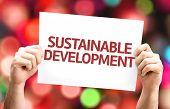 stock photo of sustainable development  - Sustainable Development card with colorful background with defocused lights - JPG