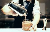 stock photo of bartender  - Bartender is making cocktail at bar counter  - JPG