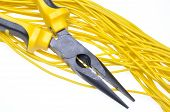picture of electrical engineering  - Pliers with electrical cables over white background - JPG