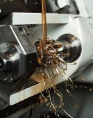 image of lube  - Close up of Orange Floating Fluid in a machine - JPG