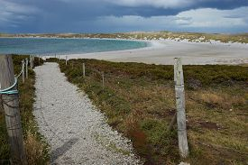 pic of falklands  - Gravel walkway leading to the curved sandy beach of Yorke Bay in the Falkland Islands - JPG