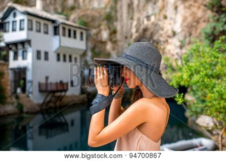 Woman photographing in Blagaj village