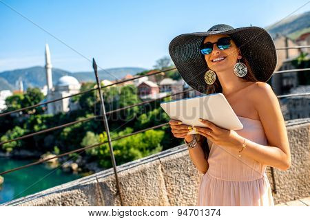 Female tourist using digital tablet in Mostar city