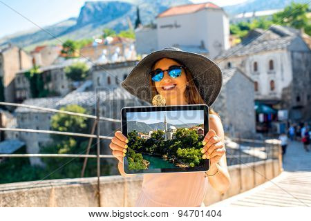 Woman promoting tourism in Mostar city