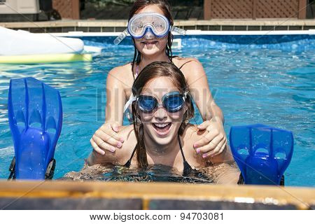 teenage sister playing in the pool
